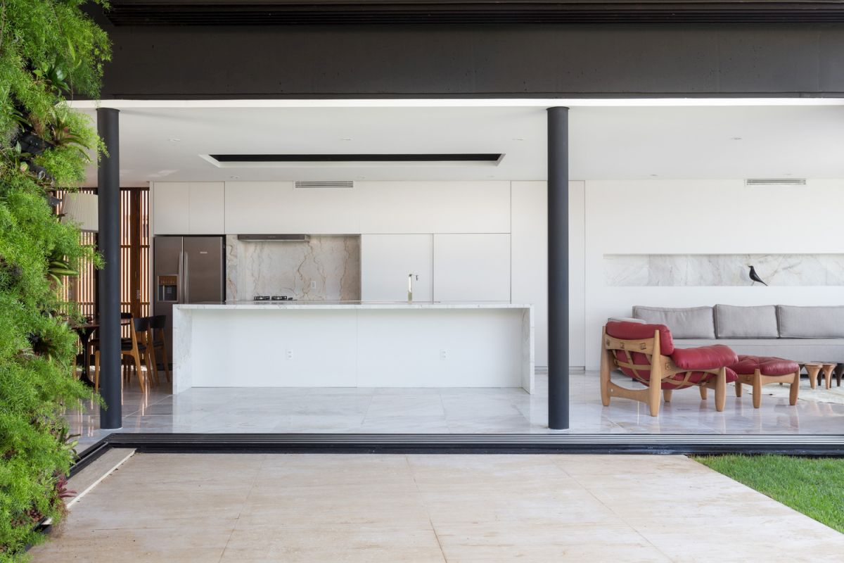 Enseada House in Brazil kitchen connected to terrace