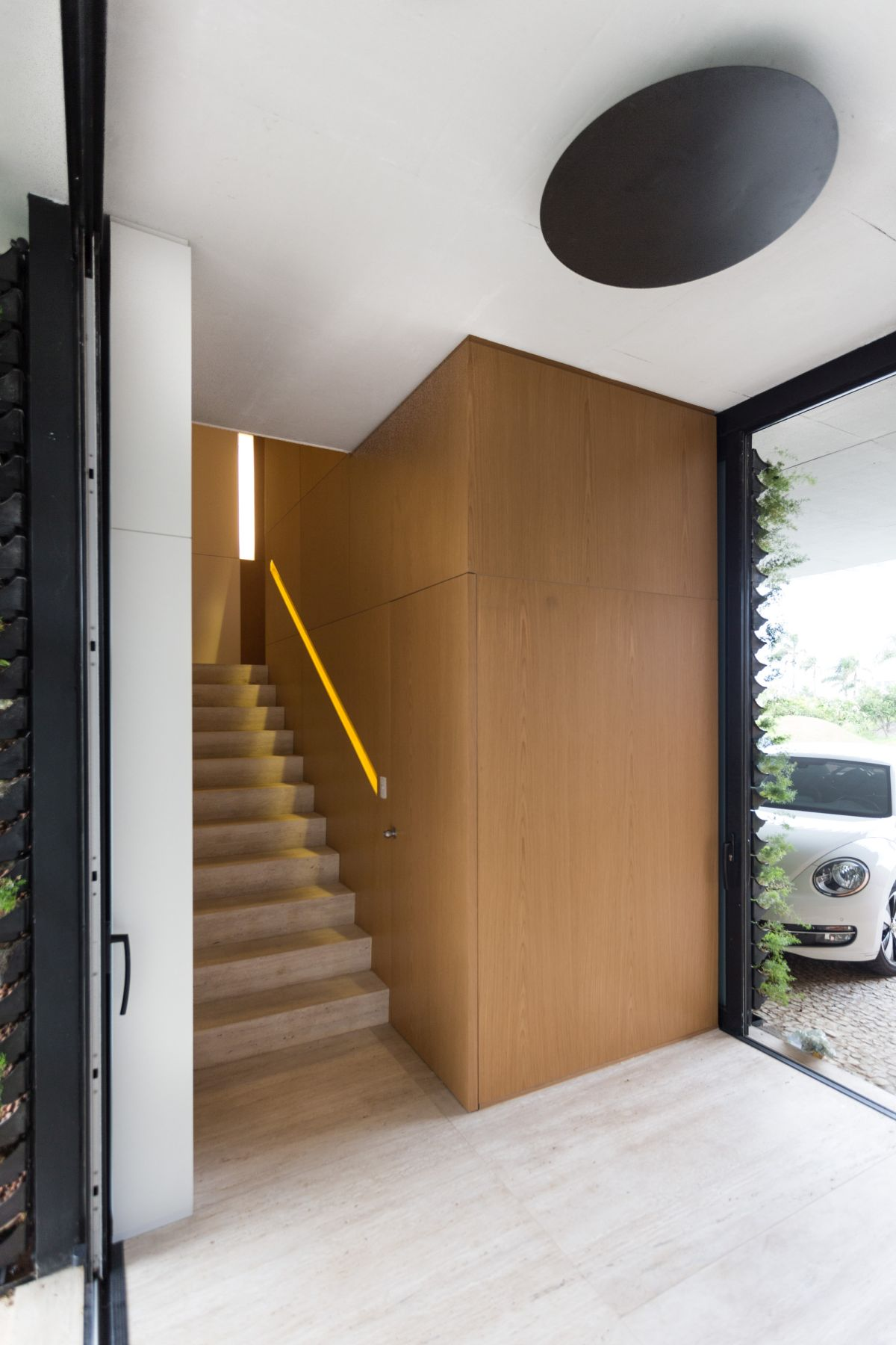 Enseada House in Brazil staircase with a cool handrail