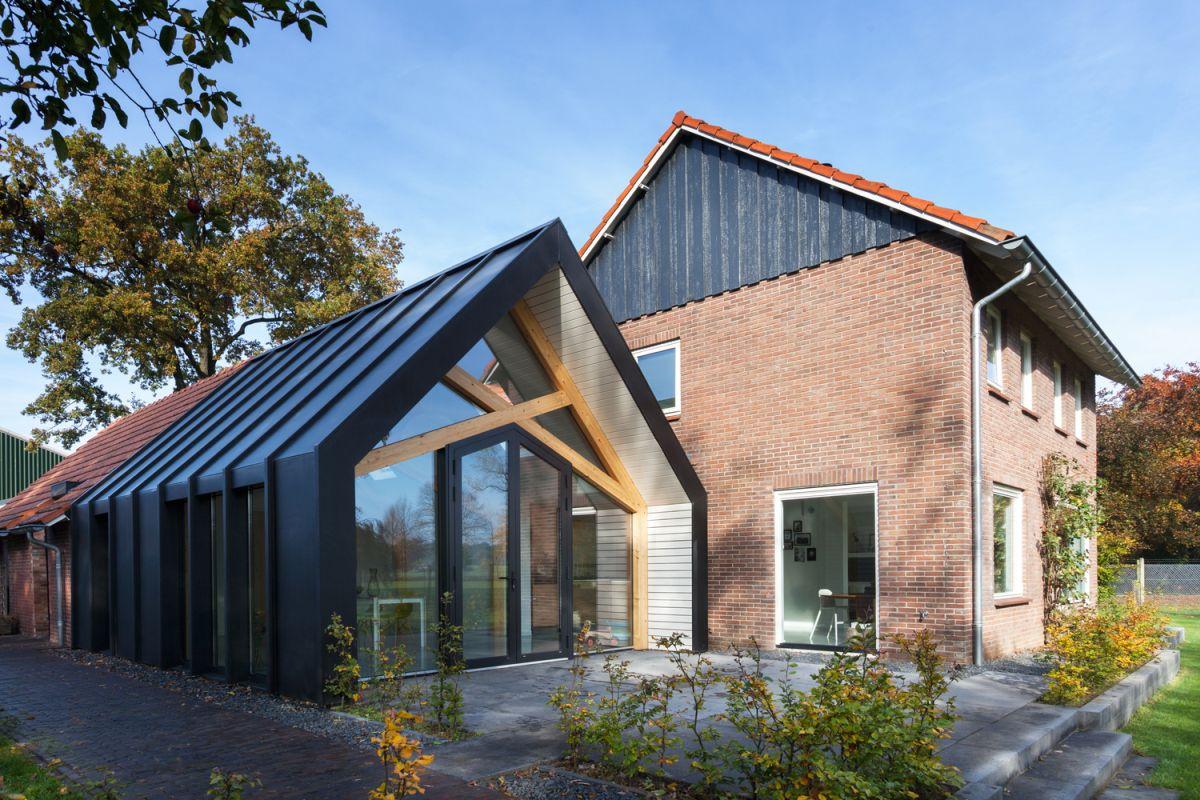 Farmhouse renovation by Bureau Fraai barn glass front