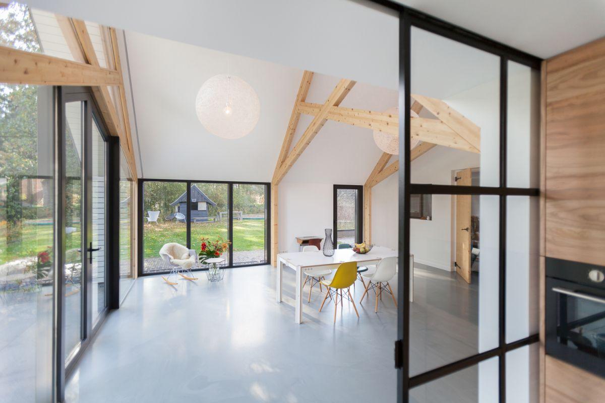 Farmhouse renovation by Bureau Fraai barn interior and glass walls