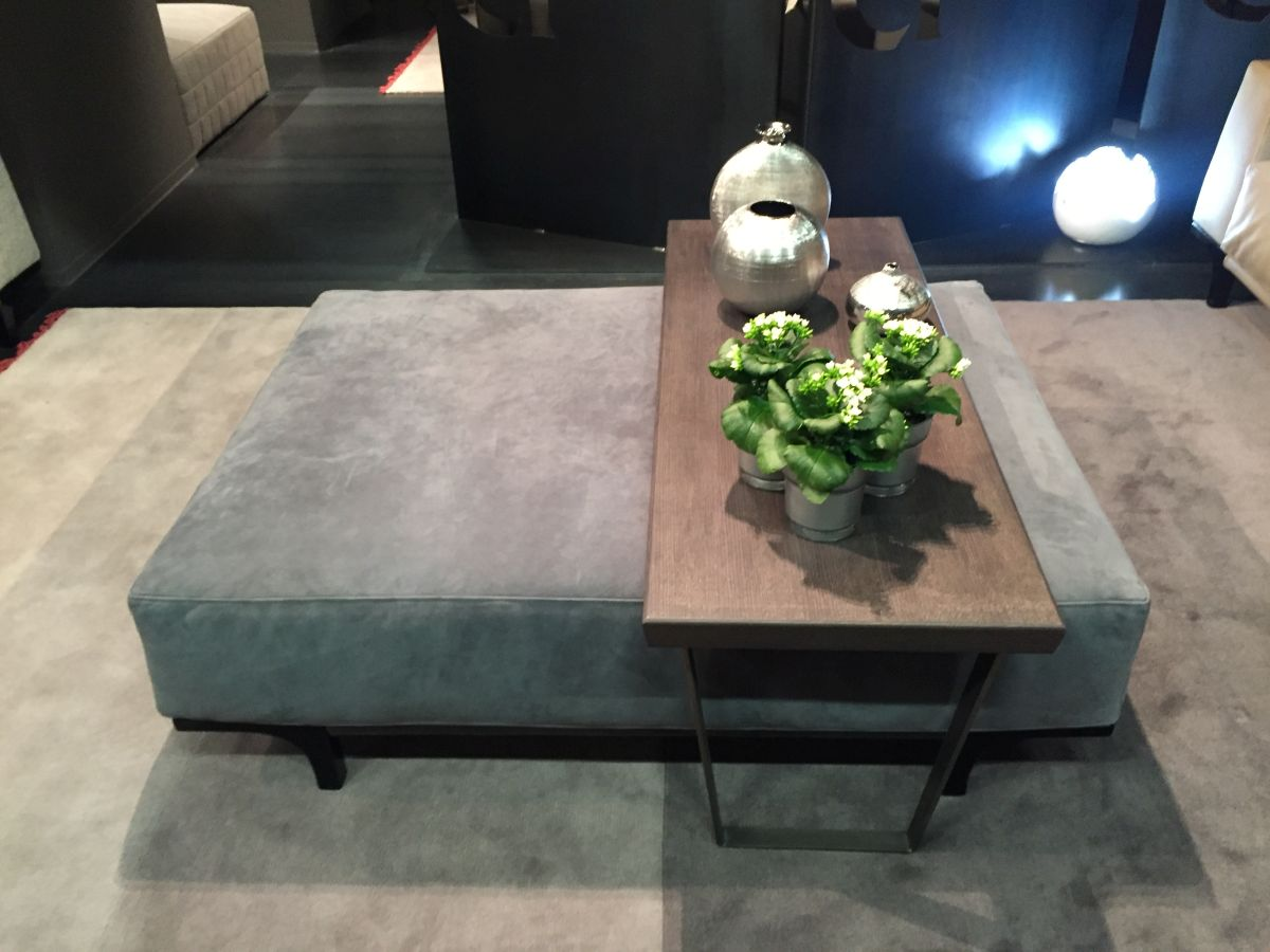 Grey ottoman chair with a table above
