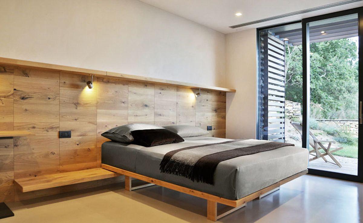 Hillside villa in Liguria bedroom wood wall