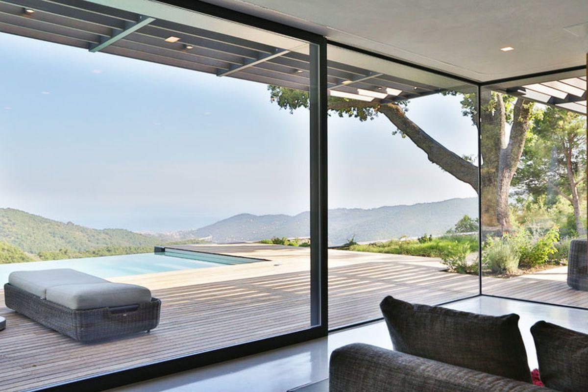 Hillside villa in Liguria interior corner glass walls