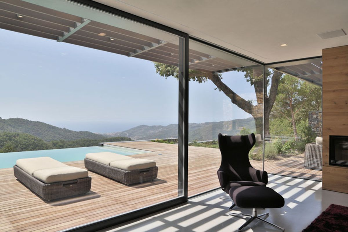 Hillside villa in Liguria interior glass walls