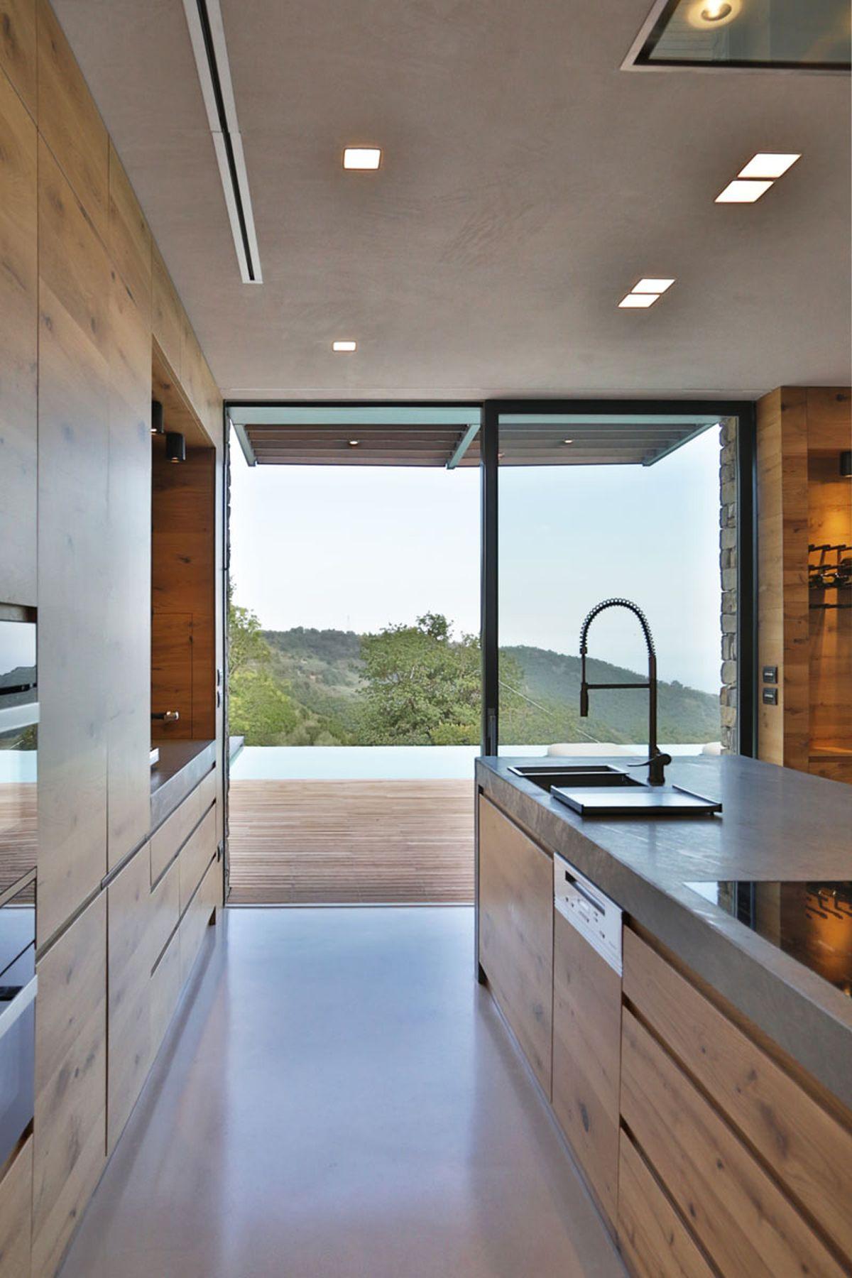 Hillside villa in Liguria interior kitchen access to terrace