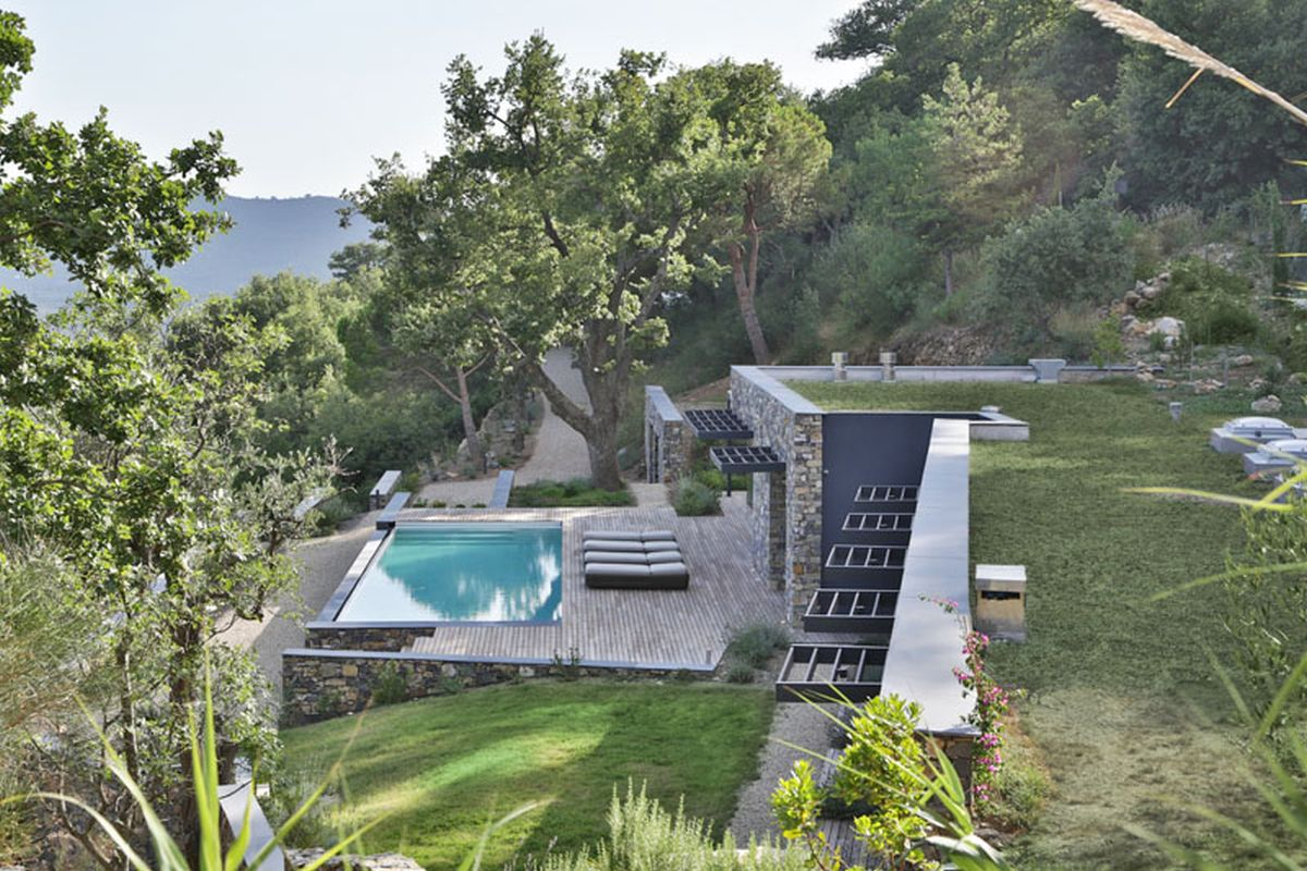 hillside home overlooks the expansive valley below