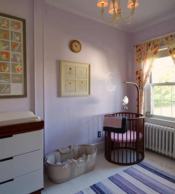 Levender charming nursery room with a round crib
