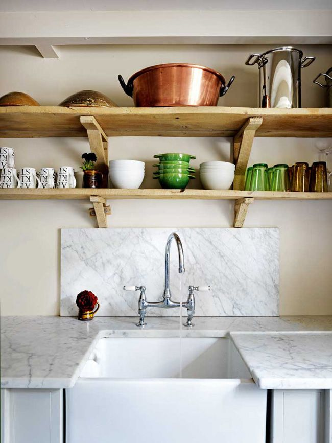 Marble backsplash behind the faucet