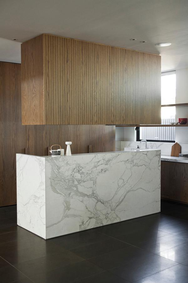 Marble kitchen island with wood