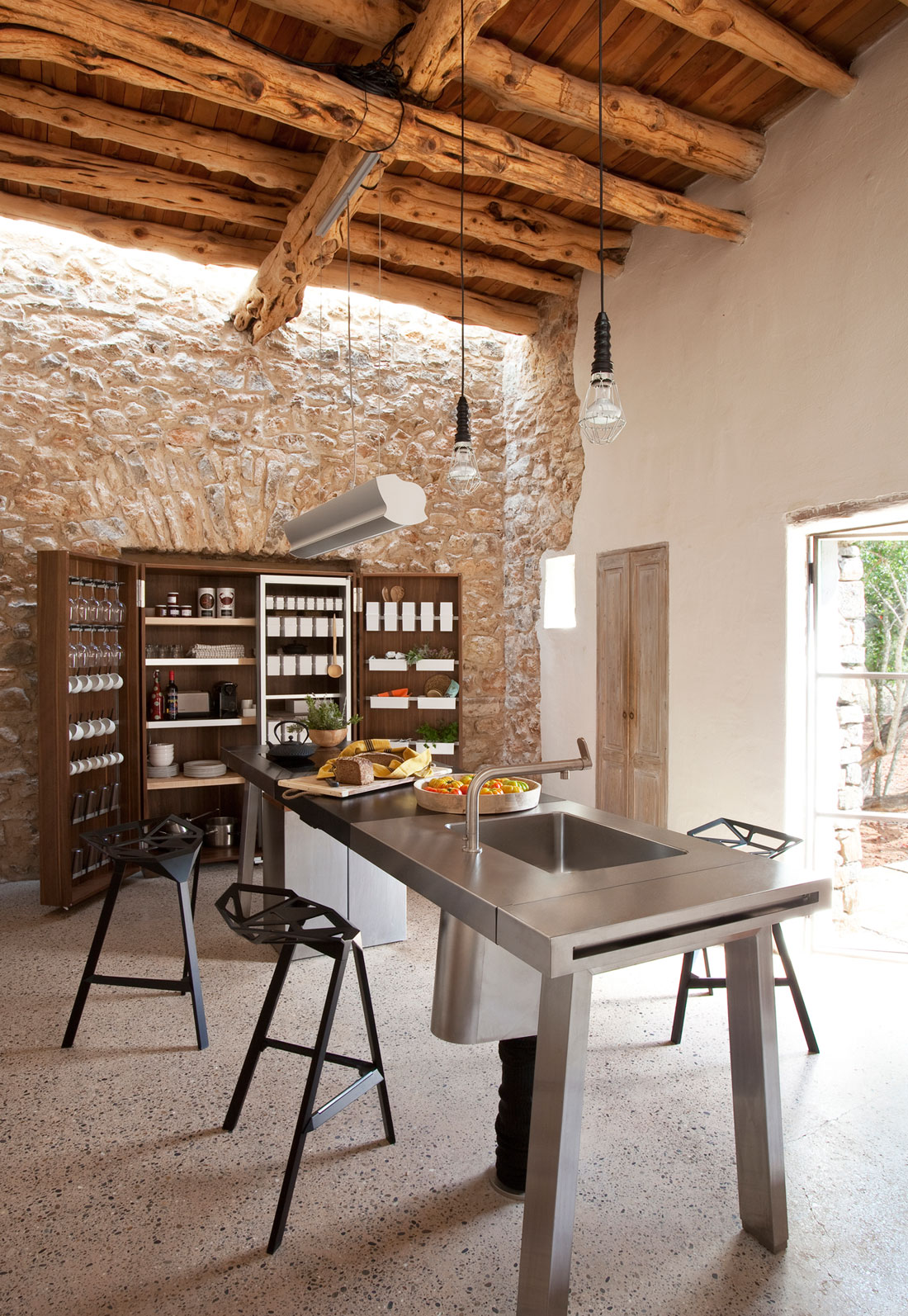 Modern Finca Can Basso transformation kitchen stone wall