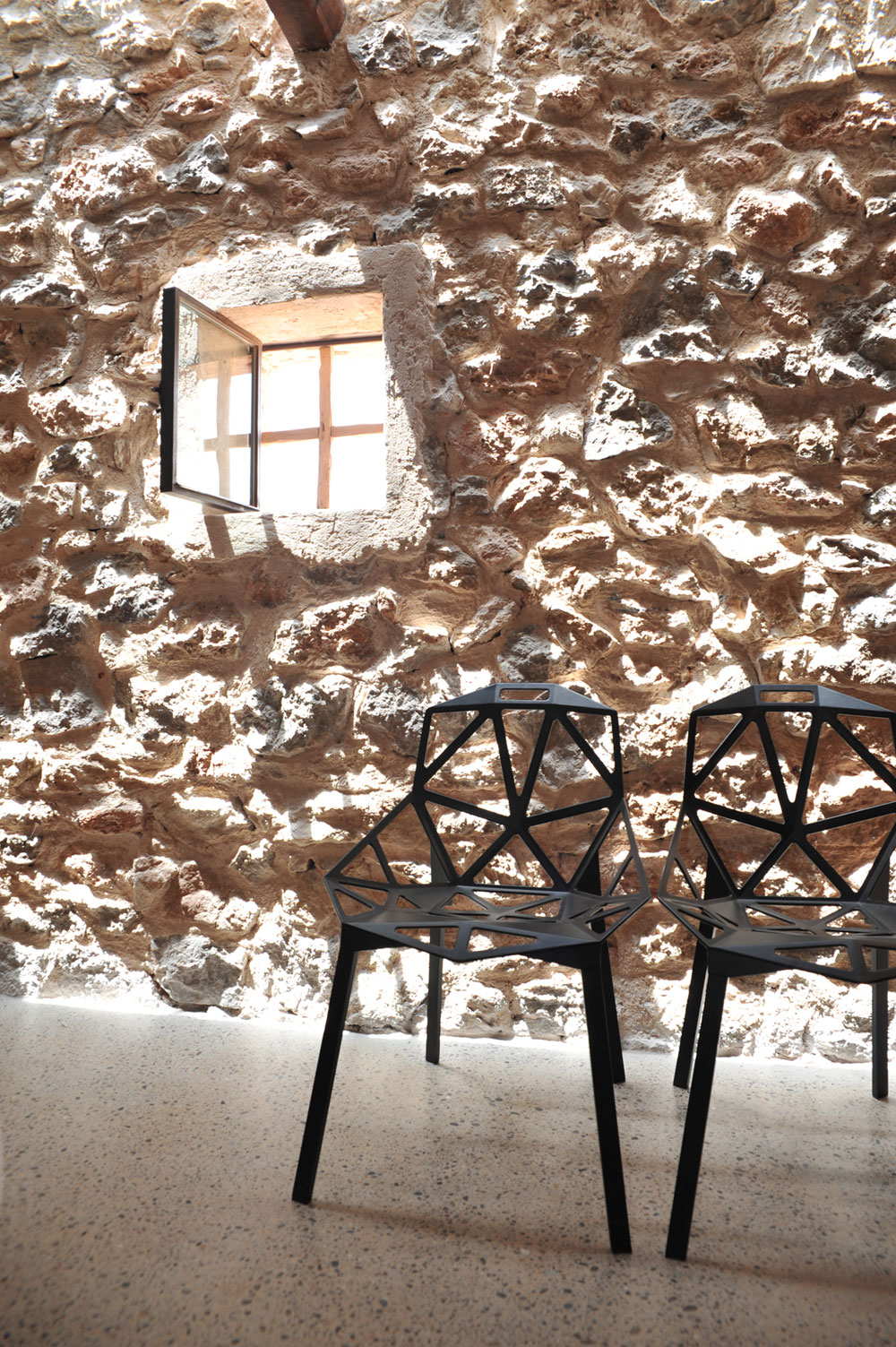 Modern Finca Can Basso transformation textured stone wall