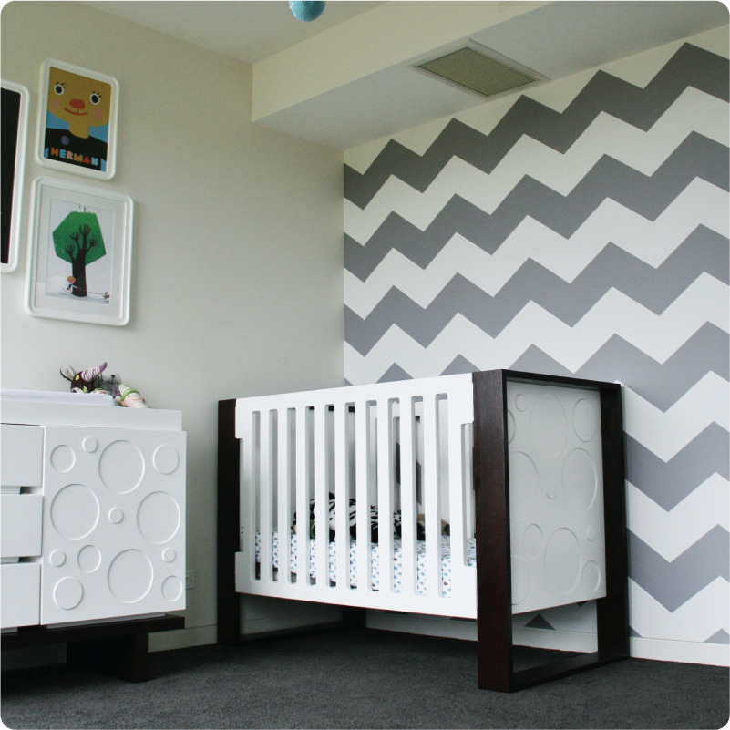 Nursery room with grey chevorn walls