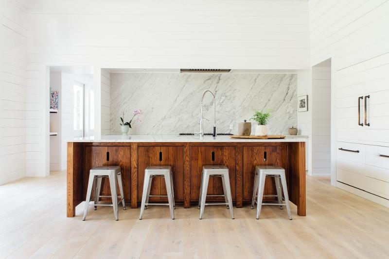 Open kitchen with marble backsplash and wood island