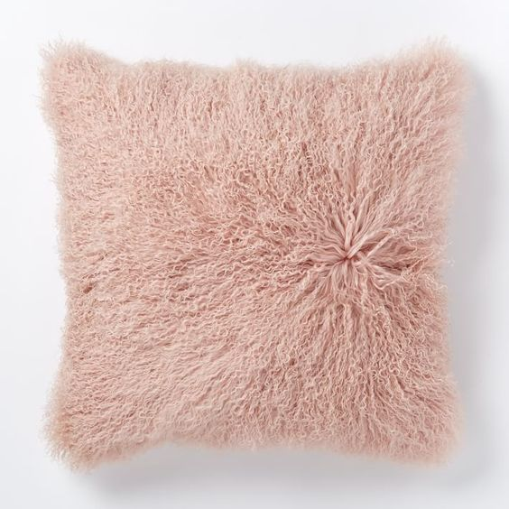 Pink sheepskin throw pillow