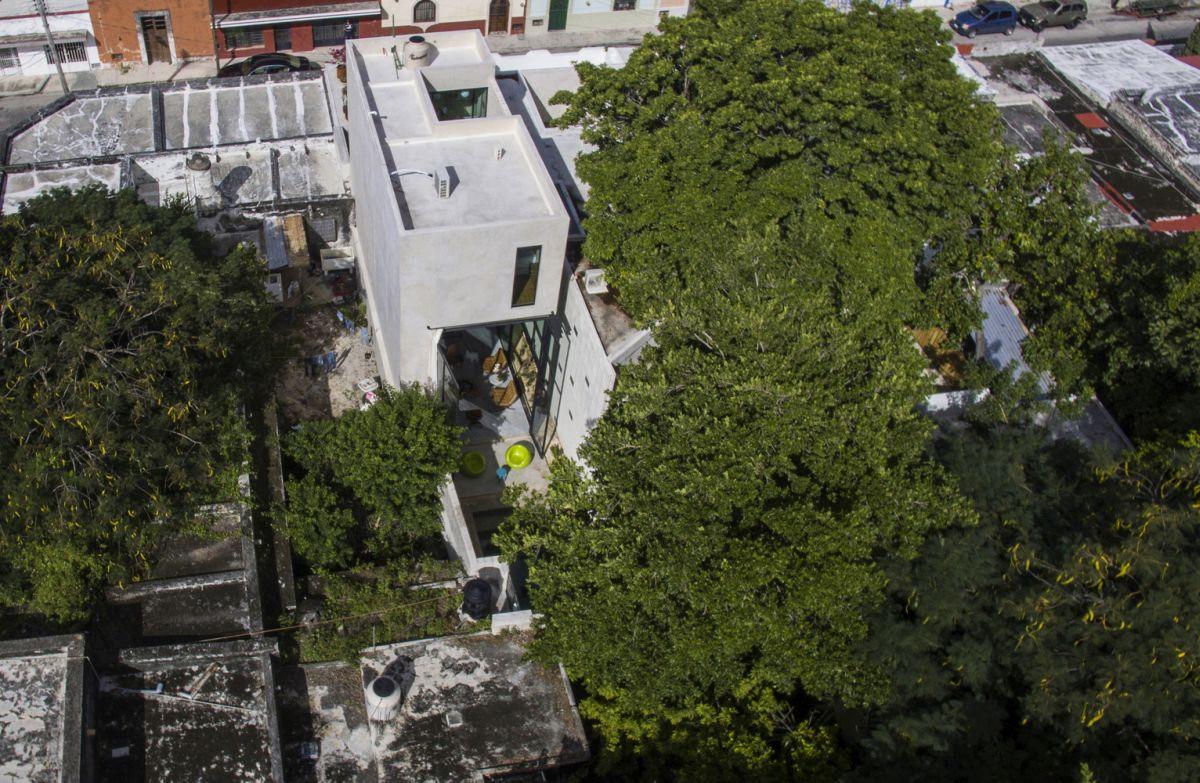 Raw House in Yucatan between buildings