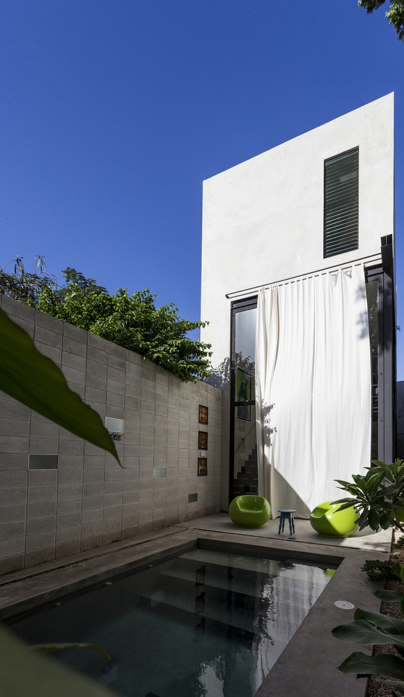 Raw House in Yucatan curtain covers glass doors