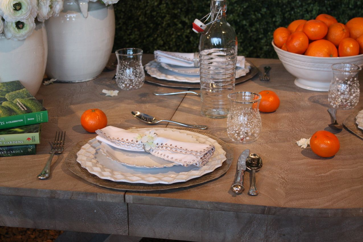 Simple and chic details like the lace edged napkin, vintage cutlery and casual drinking glasses make the setting special.