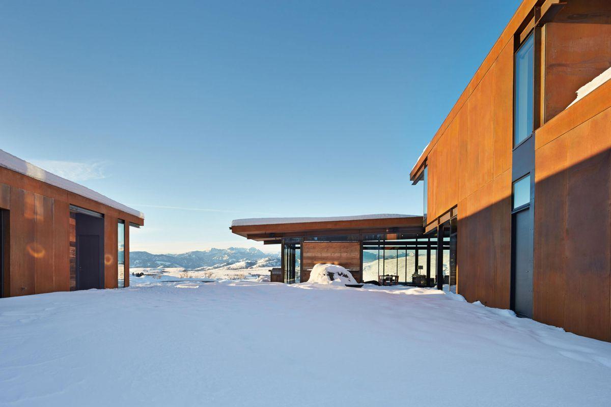 Studhorse residence space between buildings in winter