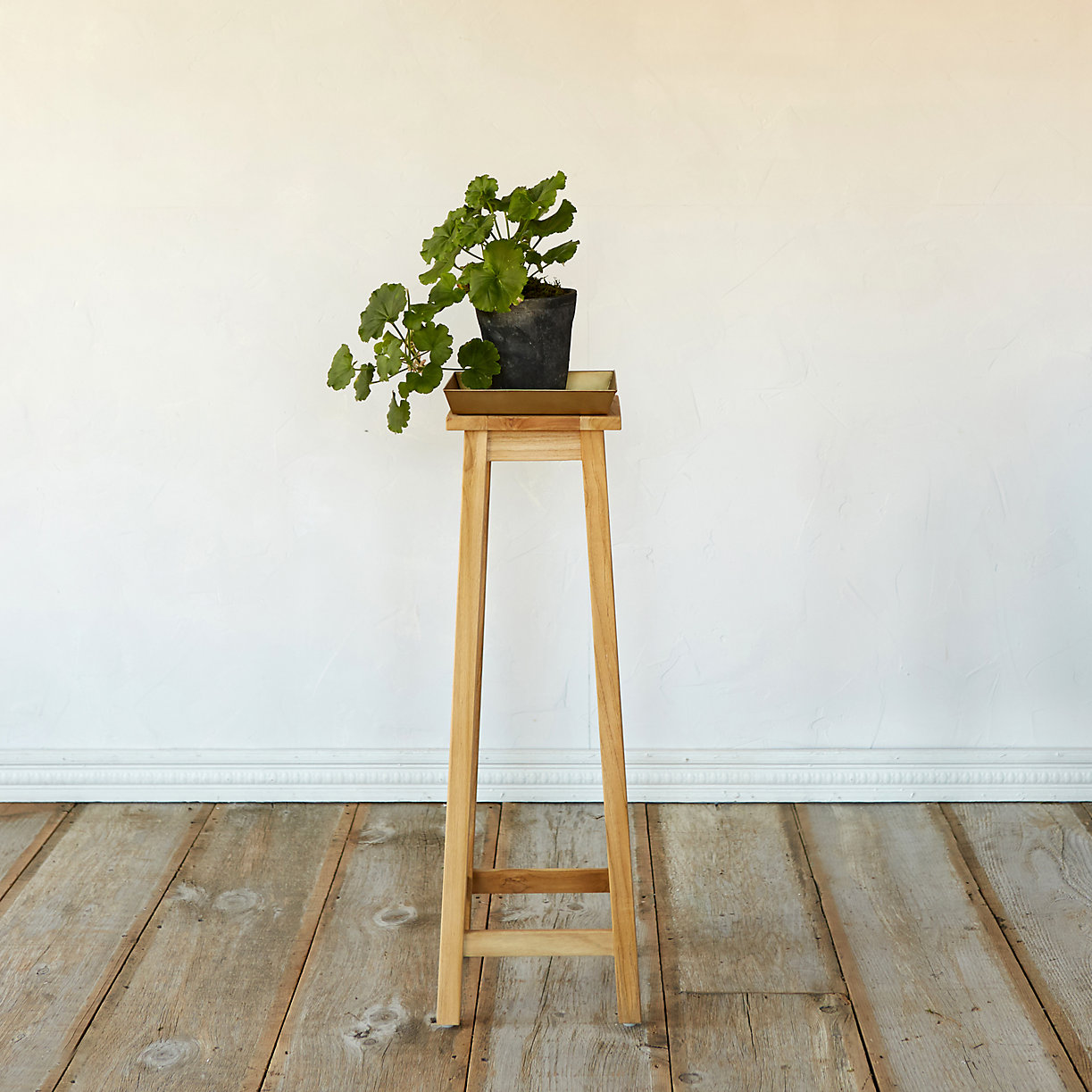 13 plant stands to give your houseplants a home. Black Bedroom Furniture Sets. Home Design Ideas