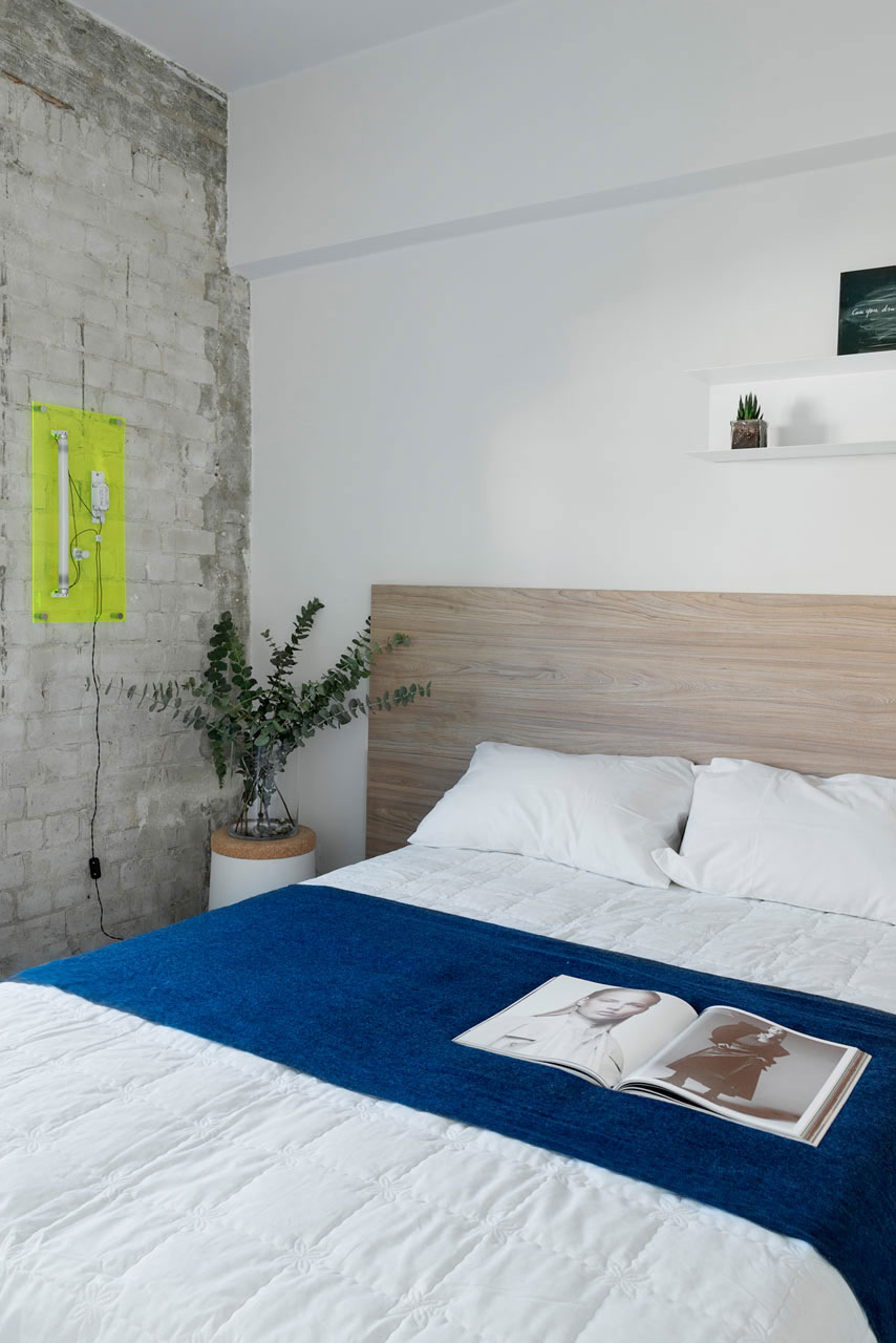 Tel Aviv apartment with Japanese design influences -first bedroom brick wall