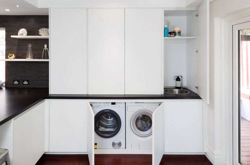 White laundry room with a modern design