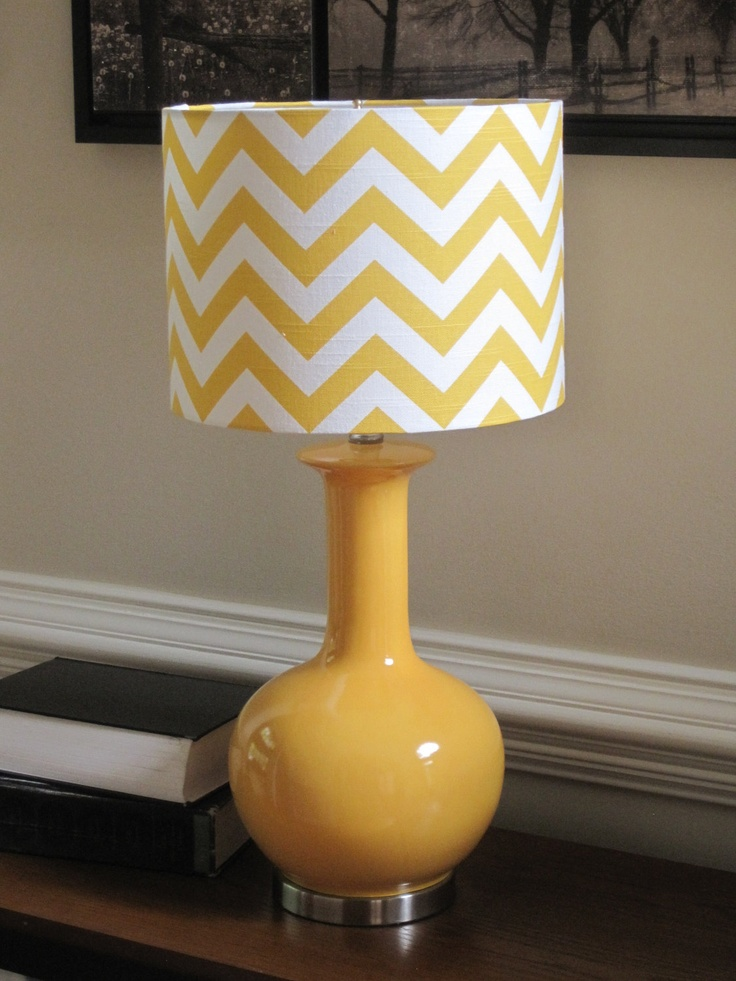 Yellow lamp shades on chevron