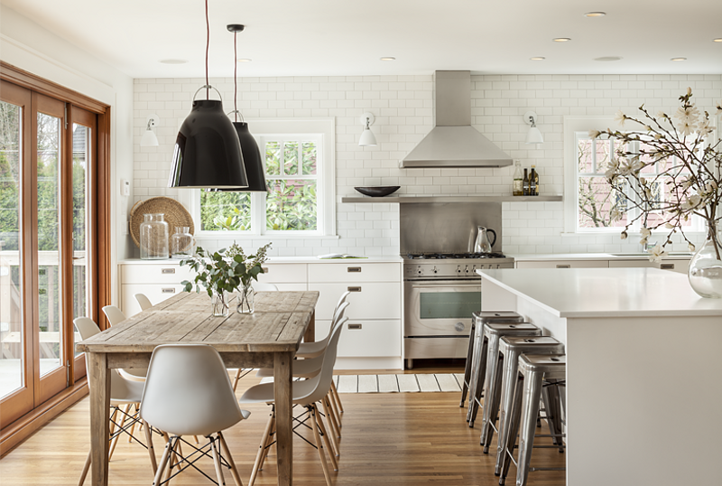 kitchen with subway tiles and farm table