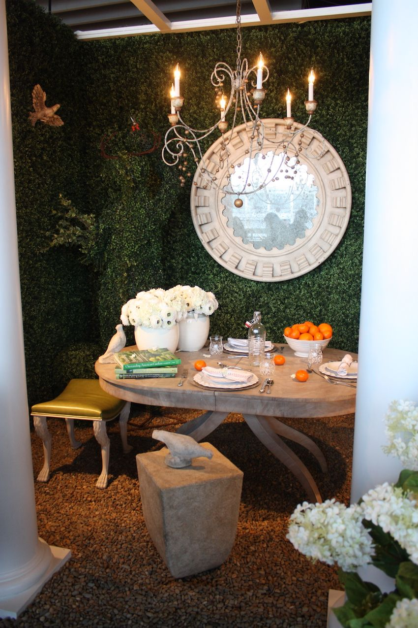 An intimate dinner for two would be perfect in this setting by New Growth Designs. Hydrangeas and a bowl brimming with tangerines adorn the natural table. The peaceful and romantic outdoor setting was designed by Mary Douglas Drysdale.