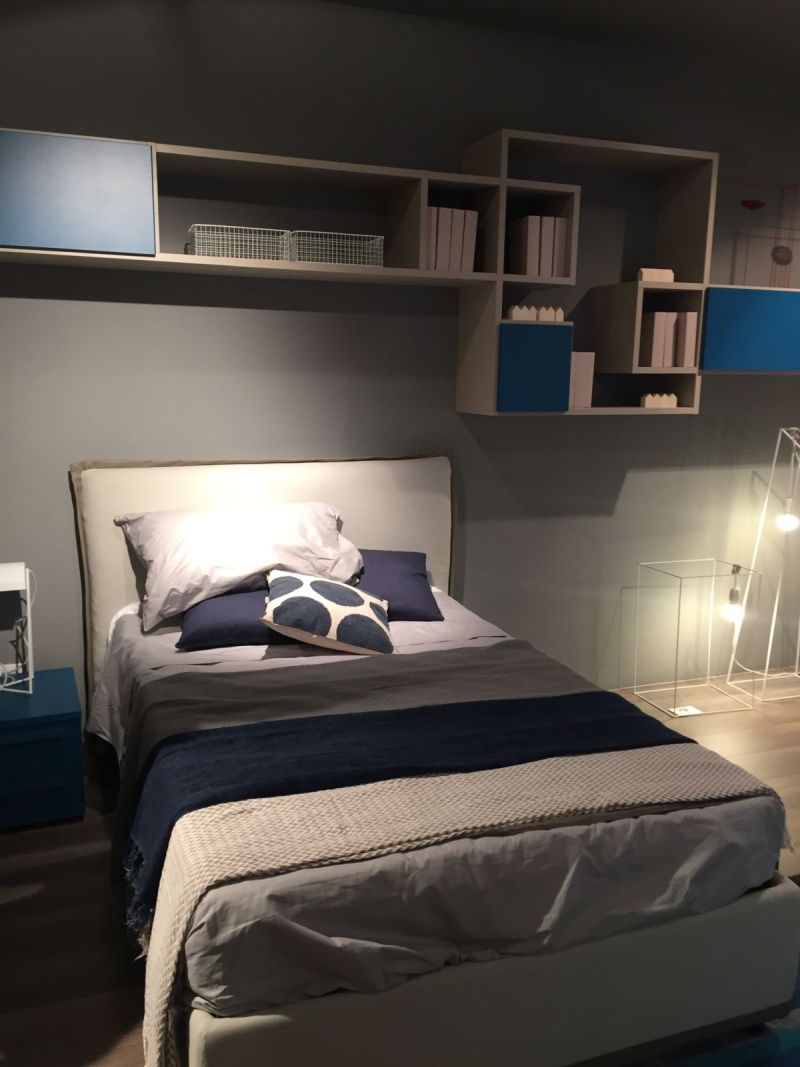 Bed and shelves above