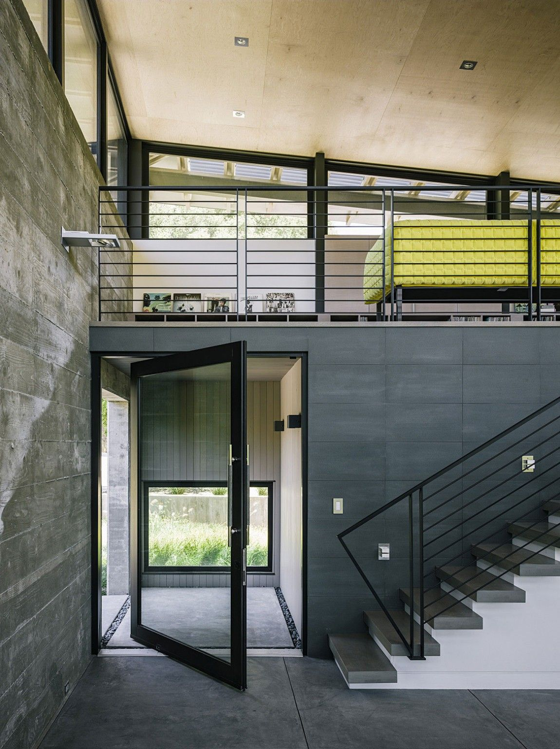 Butterfly House by Feldman Architecture pivot door