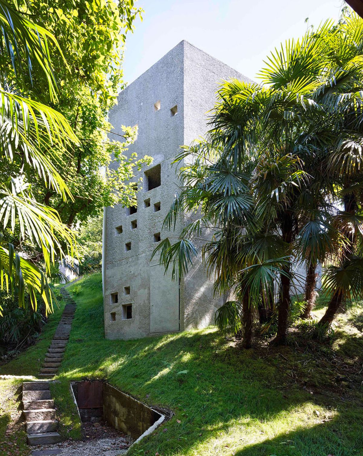 Concrete House in Caviano tall and narrow tower