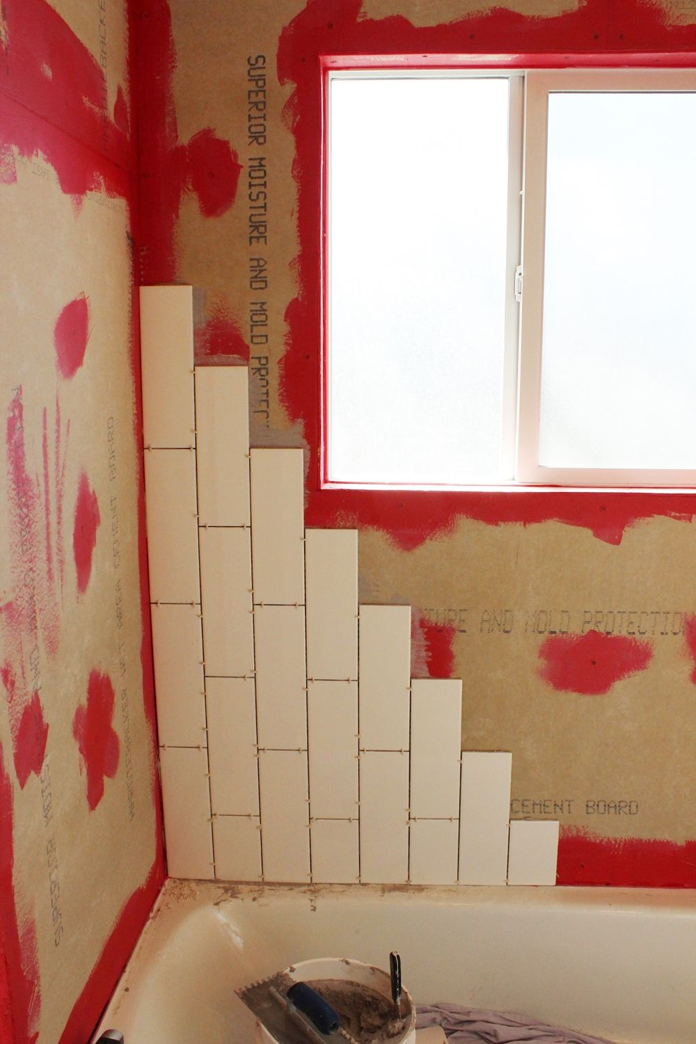DIY Tile Shower Tub Surround - staircase tiling
