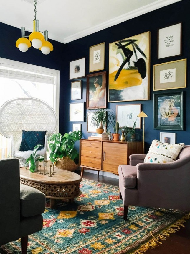 Deep blue wall decorated with frames