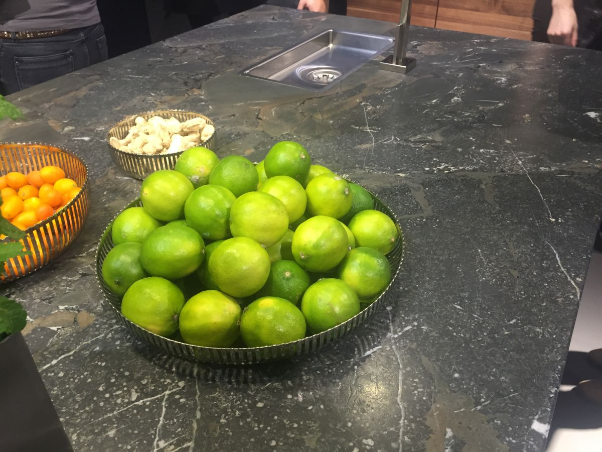 Fresh green limes on counter