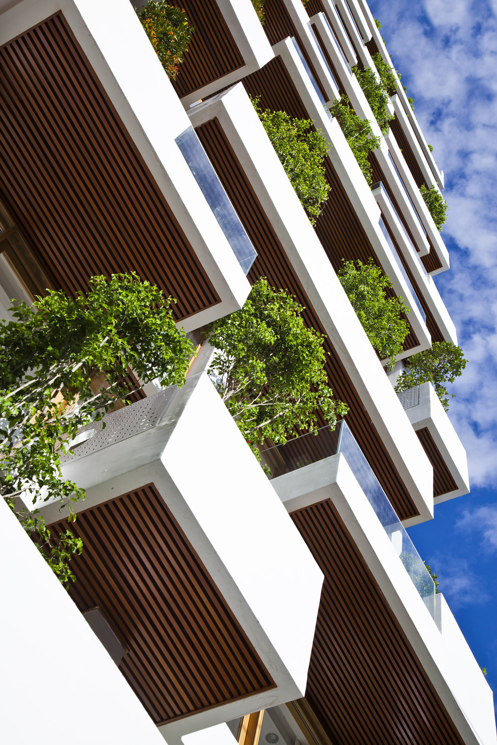 Stylish balconies become integral parts of their building for Balconies or balconies