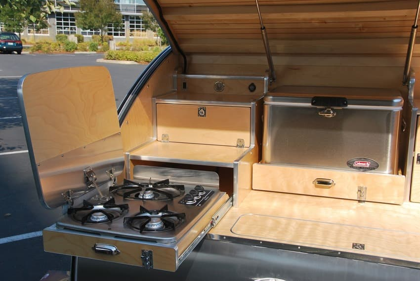 High camp teardrop trailer slide cooktop