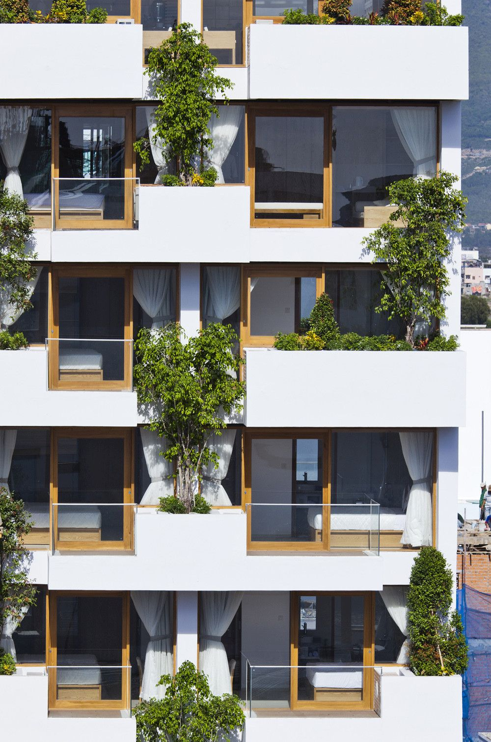 Stylish balconies become integral parts of their building for Balcony of house
