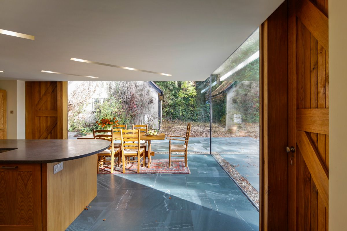 Interior with an open space extension - A Cantilevered Glazed Extension by Stephen Marshall Architects