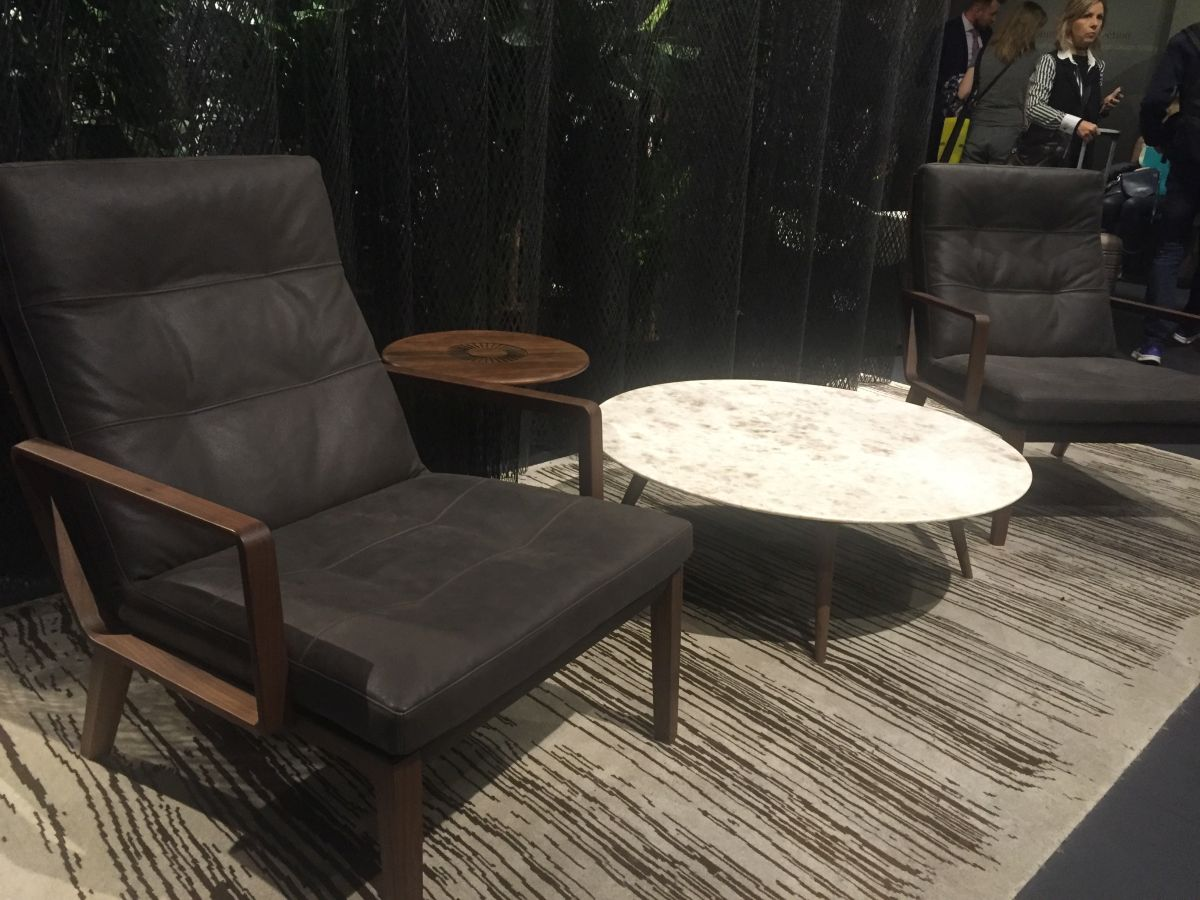 Leather low armchair and round marble table