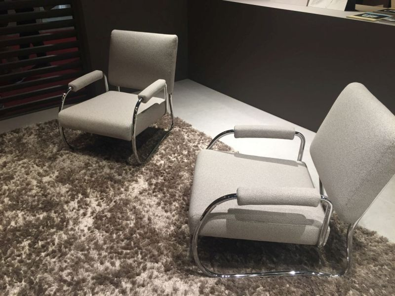 Low armchairs with a stainless steel frame