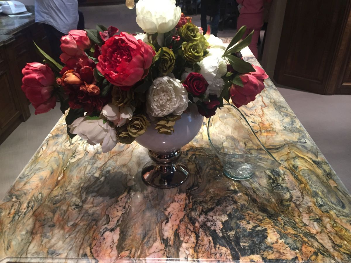 Luxury marble countertop and flower bucket of roses