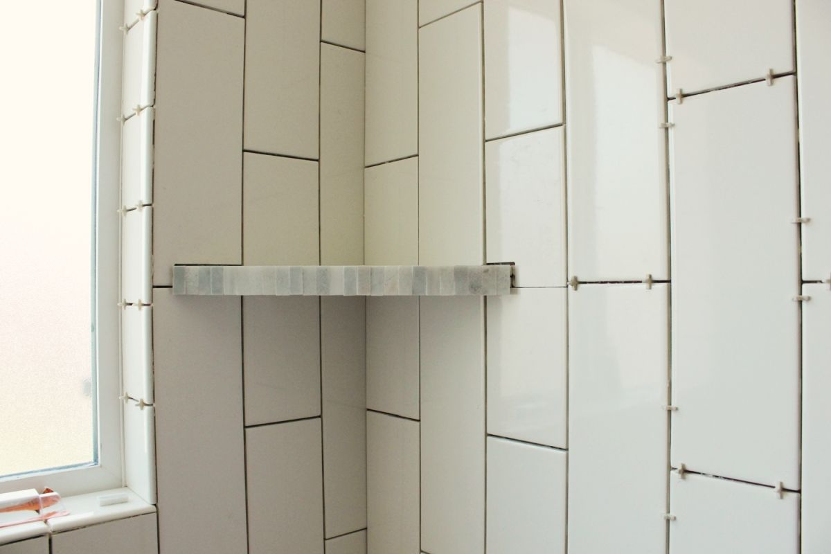 How to install a tile shower corner shelf Install tile shower