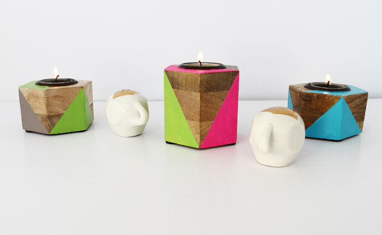 Neon painted geometric candle hlders