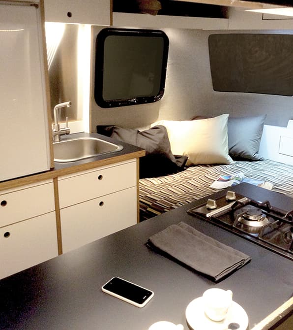 Nest caravan deign kitchen and bed