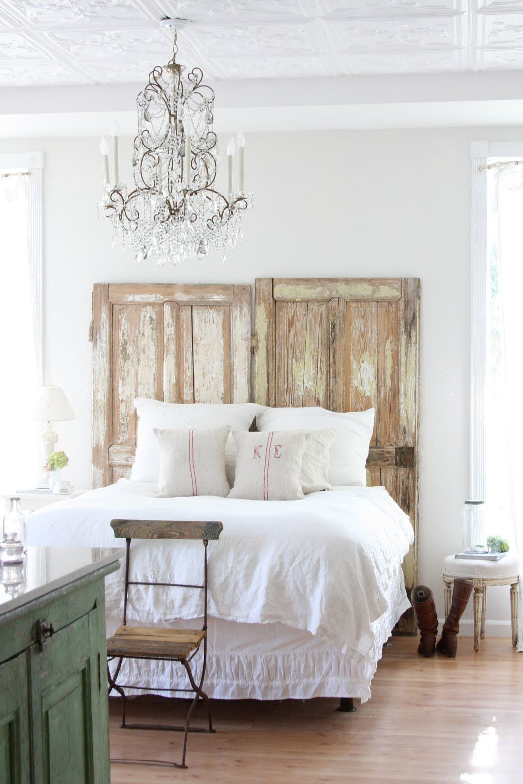 Old doors used for bedroom headboard