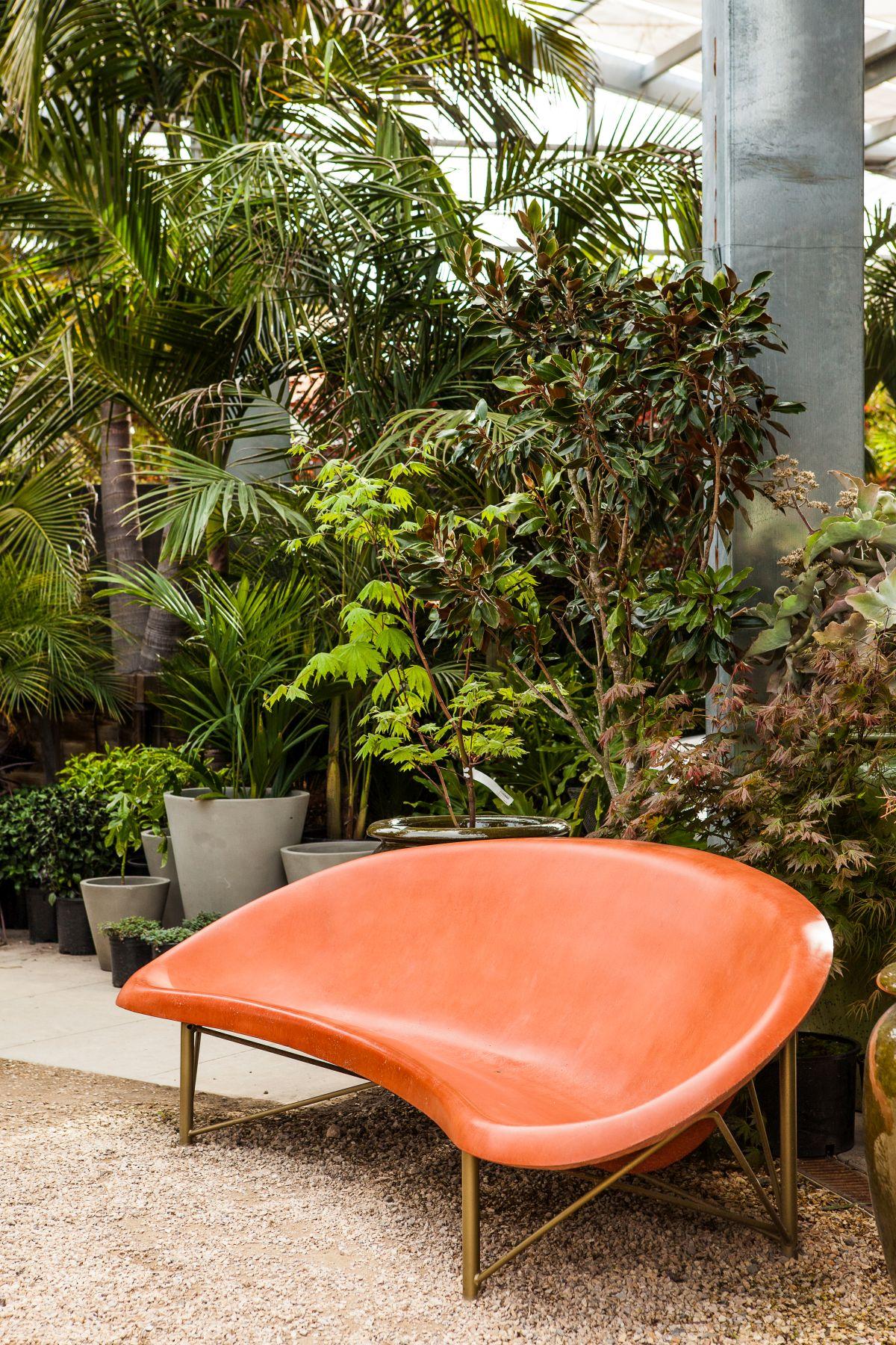 Orange heating seating with a lush vegetation behind