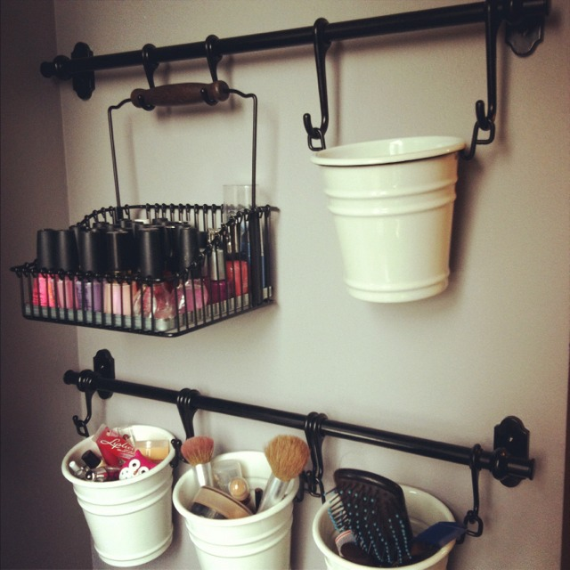 Pots hanging on a towel rack
