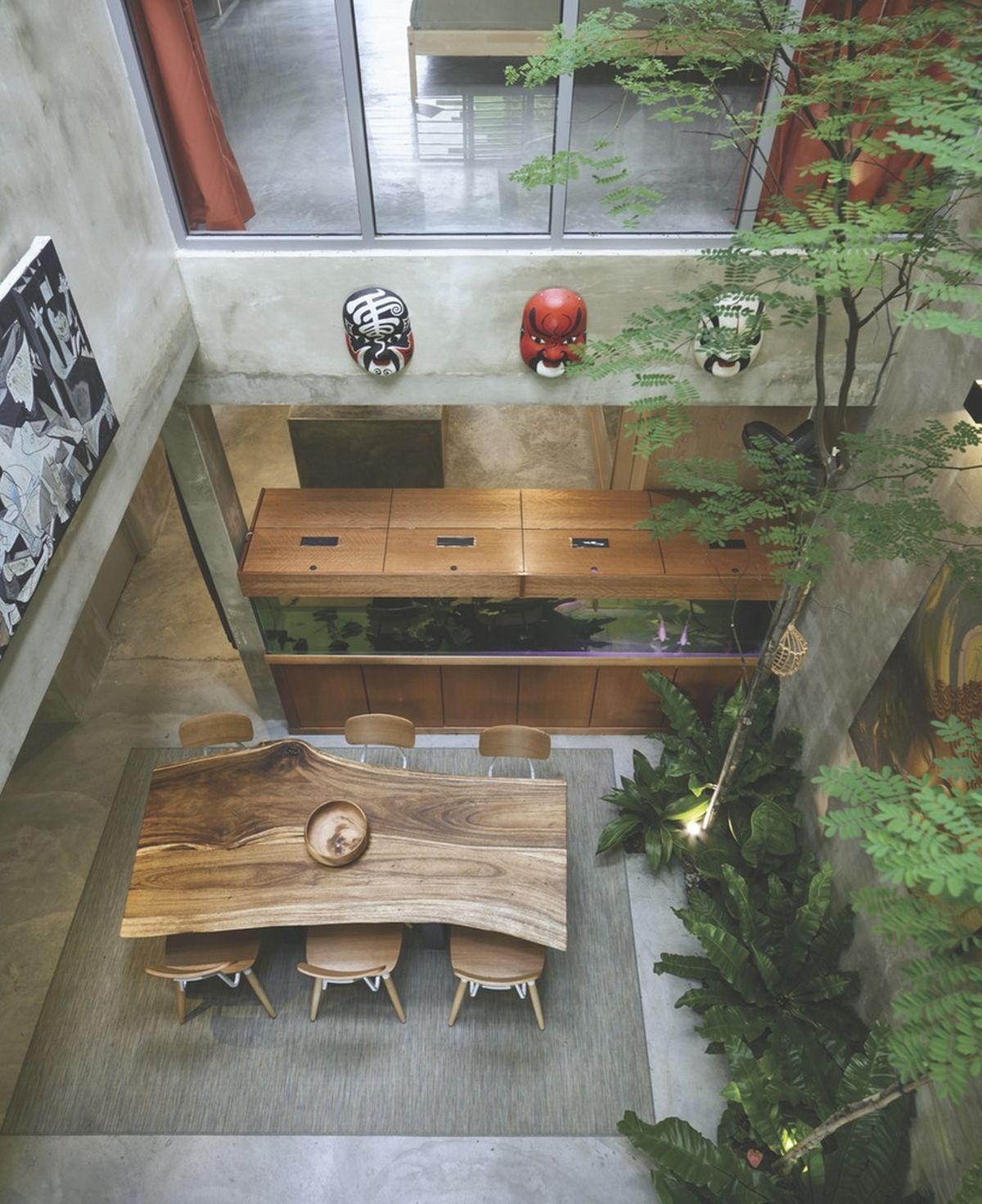 Reinvented courtyard home in Malaysia live edge dining table