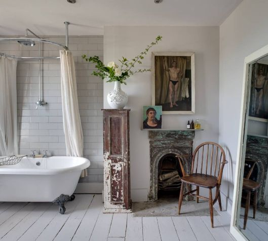 Shabby chic bathroom with Interesting Artwork