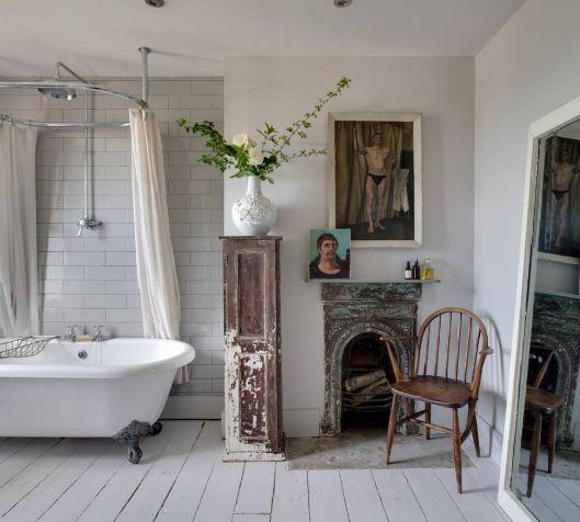 Shabby chic bathroom with Interesting Artwork